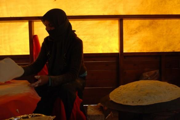 Muslim woman making bread