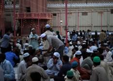 Men distrubute iftar food during Ramadan in Karachi