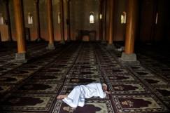 Kashmiri Muslim takes a nap at the Jamia Masjid in Ramadan