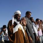 Muslim immigrants living in Greece attend Eid al-Fitr prayers in Athens.