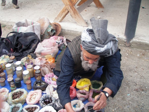 Afghani spice vendor sets up shop at the market.