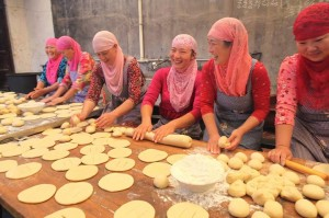 Happy Muslim women preparing Iftar.