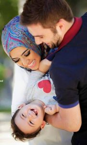 Young Muslim couple and child.