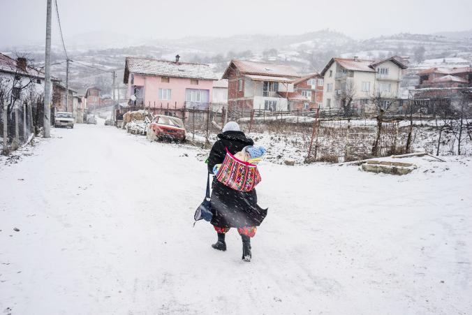 Pomak Muslim woman with her baby in the snow