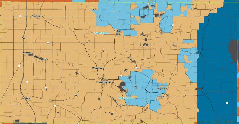 A wireless coverage map of Waushara County, Wisconsin. The tan areas of the map indicate downlink speeds between 3 and 9.99 Mbps. Red areas are even slower, while the pale and dark blue areas are faster.
