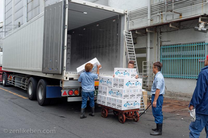 Men unloading boxes at the Tokyo Fish Market