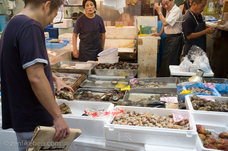 A shopper surveys some oysters at the Tokyo Fish Market