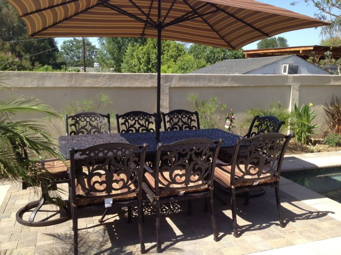 flamingo outdoor patio 9pc dining set with 44x84 table umbrella umbrella base antique bronze finish