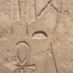 Egyptian bas relief with hieroglyphs posibly depicting aliens as gods directing the building of the pyramids