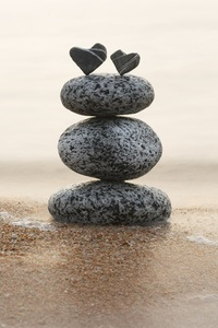 Two hearts atop a pile of stones