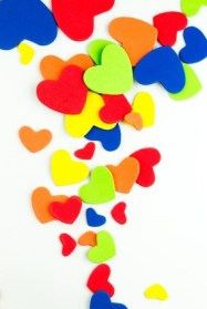 Colorful paper hearts in happy colors
