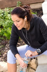 Woman wearing earbuds during her workout