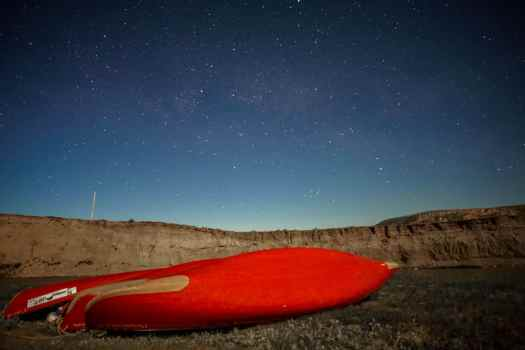 Canoes under the starry sky, ready for the Milk River Paddle!