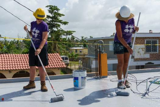 Sealing a roof with All Hands in Puerto Rico