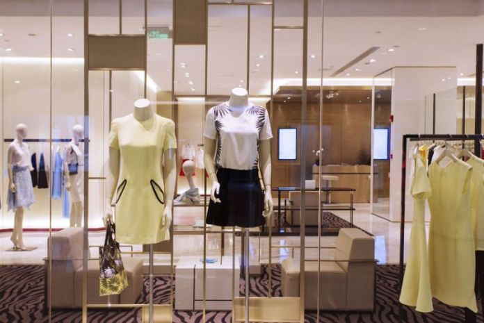 41737484 - mannequins and clothes in fashion shop