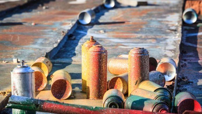 41653945 - used graffiti spray cans laying around