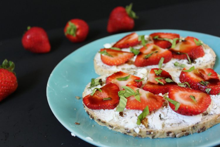 Strawberry Basil Goat Cheese Toast - tangy goat cheese paired with sweet strawberries and topped with basil and a balsamic drizzle turn everyday breakfast into a fancier affair! You can whip these up in a few minutes, and they are also perfect for snacks or served as an appetizer.