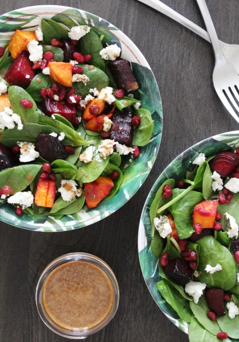 Two bowls of Beet, Sweet Potato and Goat Cheese Salad with Citrus Balsamic Vinaigrette on the side.
