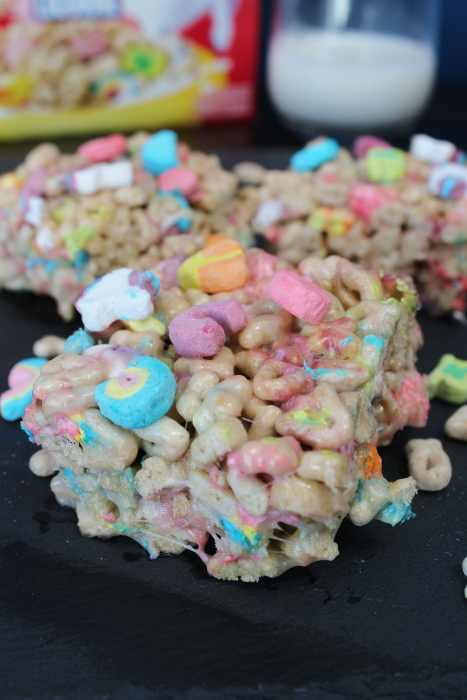 Lucky Charms Marshmallow Squares - A kid friendly gooey marshmallow treat that is quick and easy to make. They're magically delicious and perfect for St Patrick's Day celebrations!