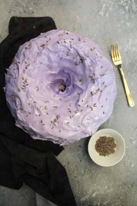 Earl Grey Chiffon Cake with Lavender Meringue Icing, and lavender buds in a bowl with a gold fork