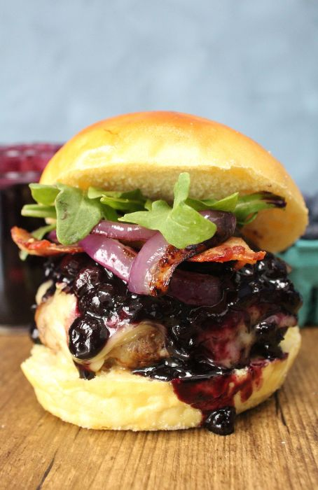 Closeup of blueberry brie bacon burger