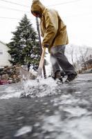 Clearing icy sidewalk