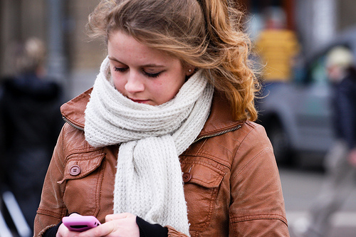 Too many children are walking while distracted by cell phones or music.