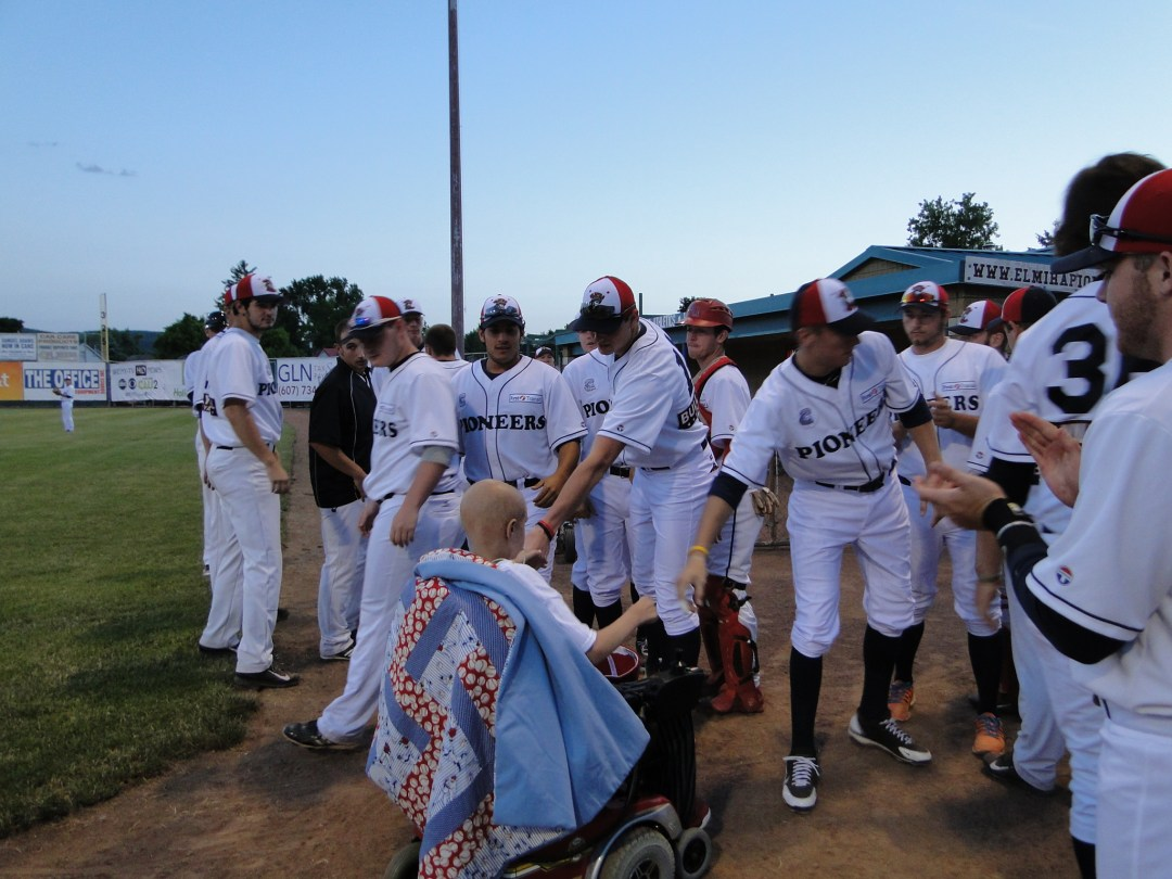 Dakota Dickerson meets the Pioneers after throwing a pitch in the fifth inning of Friday night's game.
