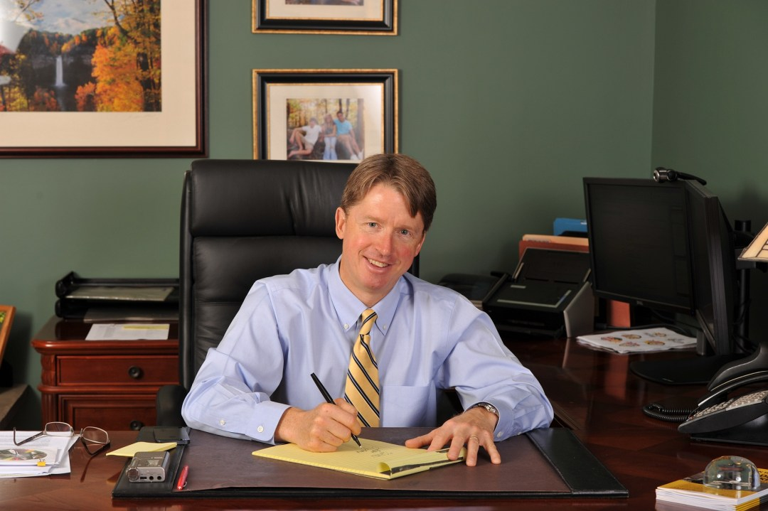 Jim Reed at desk - Ziff Law's Jim Reed Again Named Among Best Lawyers In National Directory