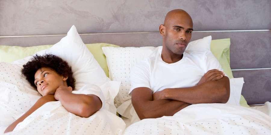 Unhappy-black-couple-in-bed | Zikoko!