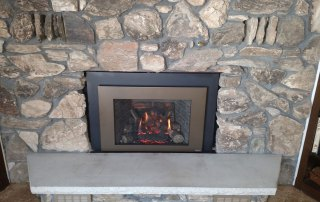 Fireplace X 430 Gas Insert with Bronze Shadow Box face and Custom Cut surround