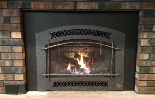 Fireplace X 34DVL gas inset with Charcoal Artisan face and Custom cut inside fit surround