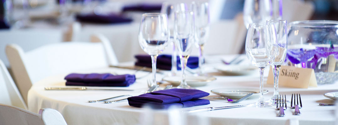Purple wedding menu cards on a placesetting.