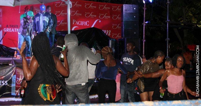 Fans dancing in the rain PIC: T. NDABAMBI | ZIMBOJAM.COM