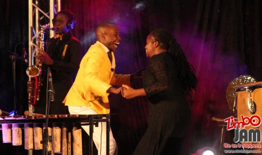 Bled dancing with his backing vocalist.
