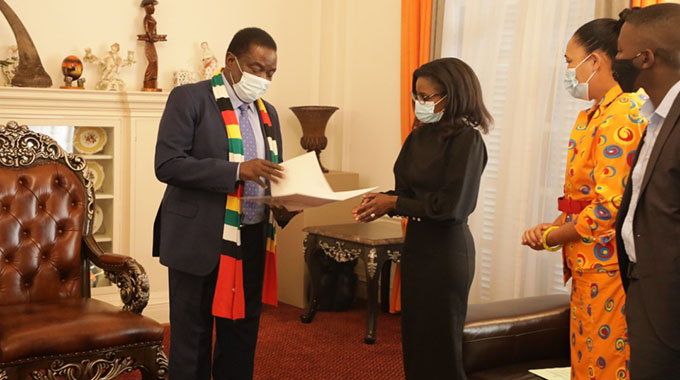 President Mnangagwa hands over PhD certificate to Matiza's widow at State House in Harare