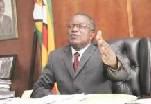 GUMBO TWIDDLES THUMBS WHILE MINISTRY BURNS