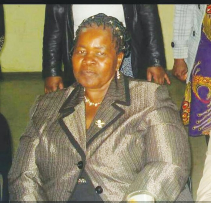 DOUBLE TRAGEDY :GRIEF STRICKEN MOM COLLAPSES, DIES UPON SEEING SON'S COFFIN