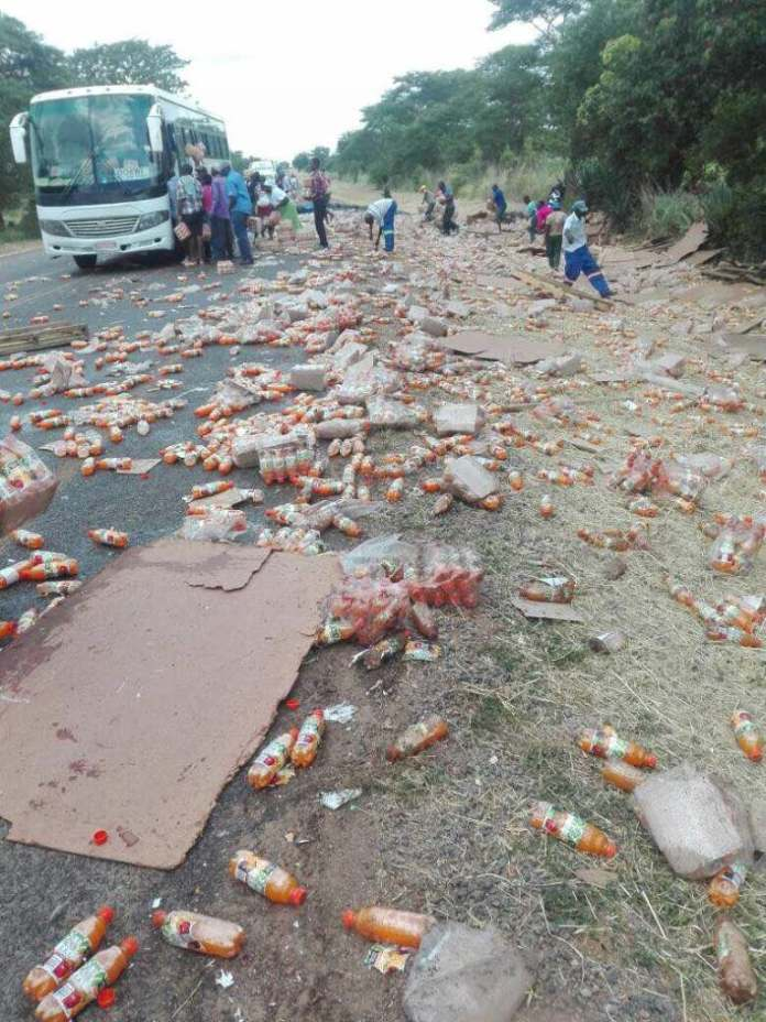 JOY for looters as Haulage truck with minute maid consignment overturns
