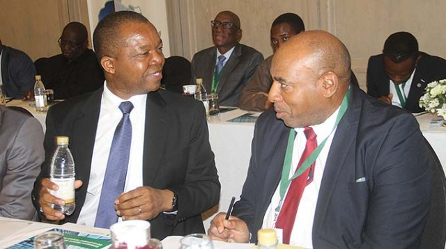 Reserve Bank of Zimbabwe Governor Dr John Mangudya (left) chats with Accountant General Daniel Muchemwa at a Private Sector Development Round-Table event in Harare yesterday