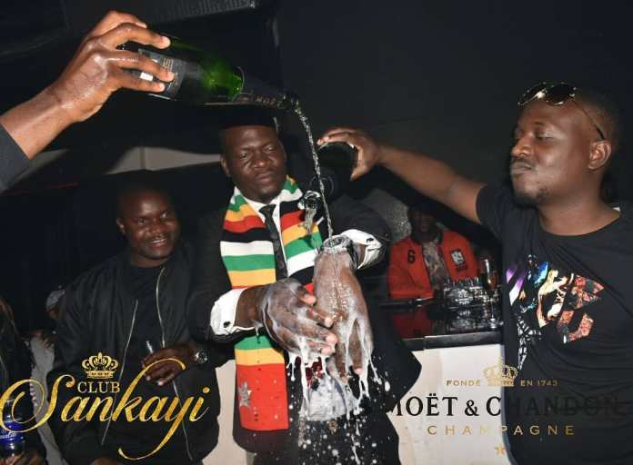 ZANU PF Big Spender Washes Hands With Expensive Champagne