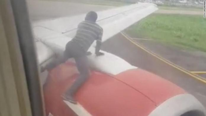 Man jumps on the plane wing as it prepares for takeoff