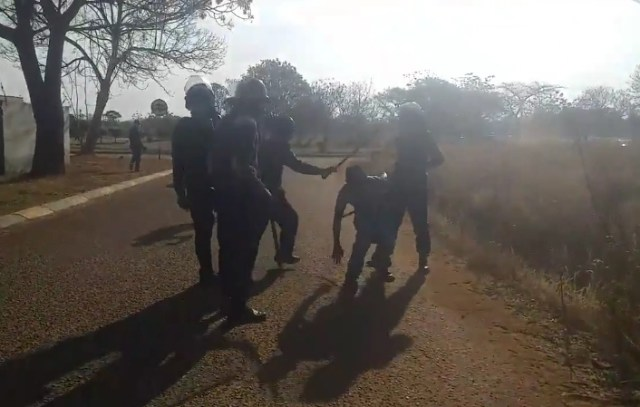 Zimbabwe Police Caught Live On Camera Beating a man with Button sticks