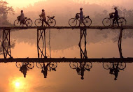 bicycle riders over a bridge