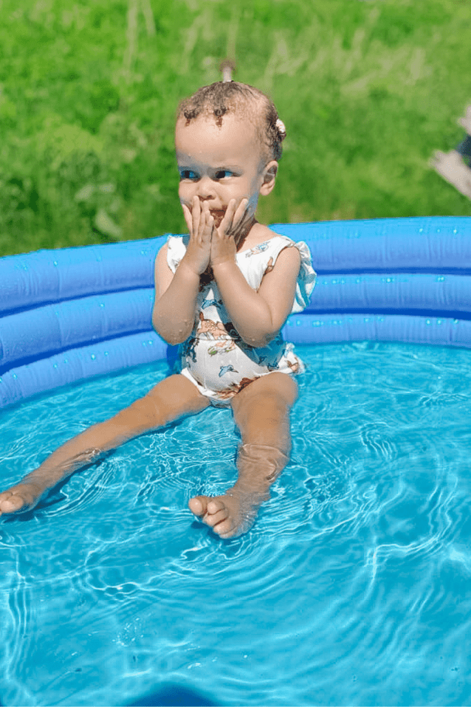 toddler in a pool