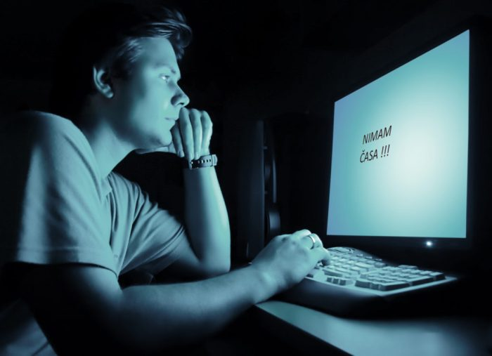 Man in front of computer screen. Dark night room and blue light.; Shutterstock ID 11514280; PO: aol; Job: production; Client: drone
