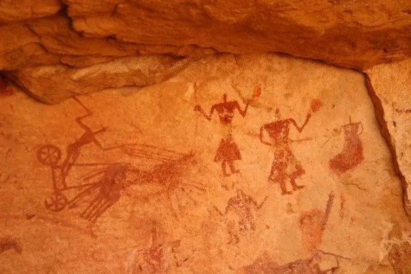 A cave painting in Jebel Acacus, modern day Lybia. Along with many other, this painting is 12 000 years and is among some of the best works found anywhere else in the world. source