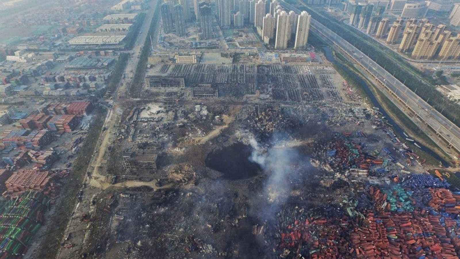 The huge crater left in the wake of the explosion in Tianjin, China.(EPA)