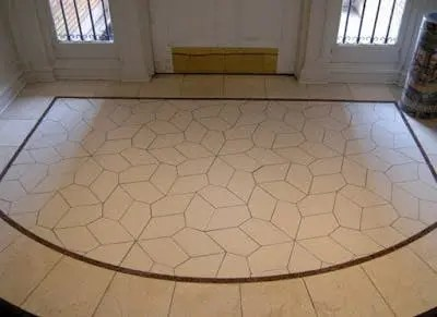 The entry foyer of the  Mathematical Association of America's building was designed using the congruent pentagons discovered by Marjorie Rice.