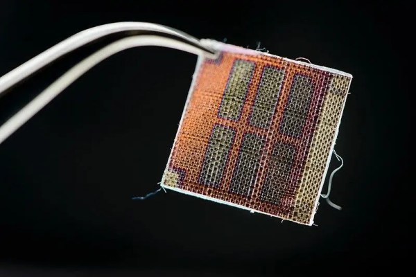 Six rectangular cells made from conductive polymer coated onto a fabric. Credit: Jeff Miller/UW-Madison